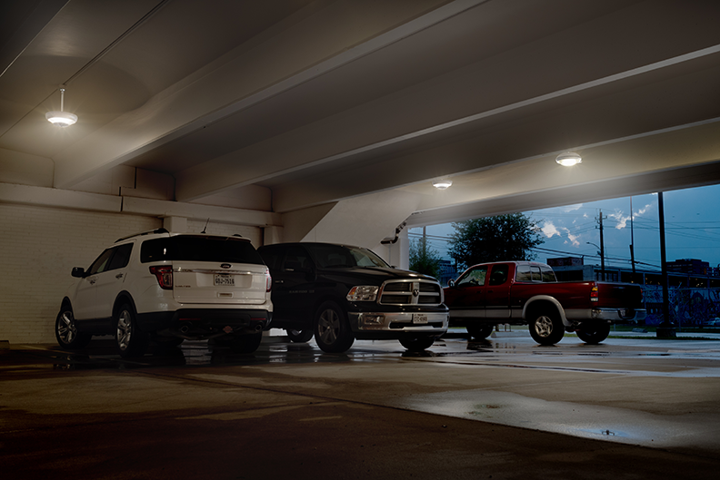Shadowy parking garages are uncomfortable and dangerous places that invite crime and car accidents amerluxs chaperone led lighting offers a cost effective